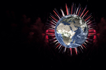 Planet earth with red and white firework on black background. Planet Earth day concept. Elements of this image were furnished by NASA