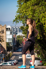 female fitness athlete sstanding in an urban setting