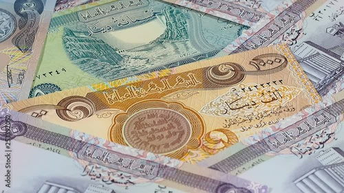 Iraq currency dinar notes rotating  Iraqi money  Low angle