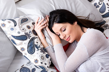 Portrait of a young pregnant woman while sleeping in an underwea