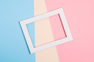 Colorful paper background with white wooden frame