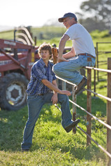 Man and his teenage son working on a farm