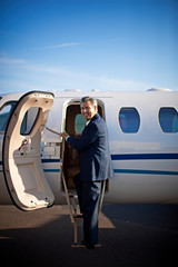 Businessman about to board a private jet
