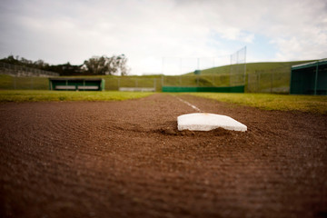 Base in the dirt of a baseball diamond.