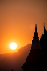 Sunset at public temple in Champasak town, Laos