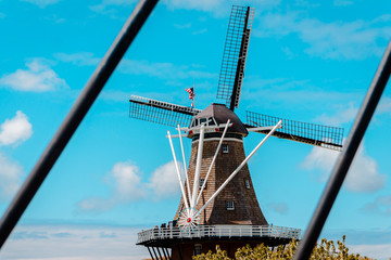 Canvas Prints Swan Framed shot of De Zwaan windmill in Holland Michigan from the bridge