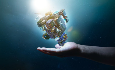 Hand holding an digital puzzle cube Earth planet  , smart global technologies concept . Mixed media