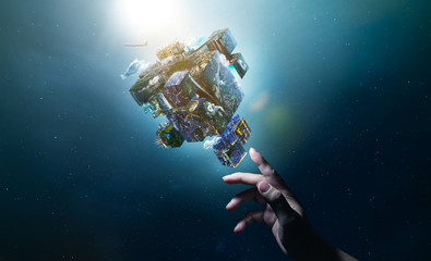 Hand of touching an digital Earth planet puzzle cube  , smart global technologies concept . Mixed media