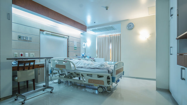 hospital recovery patient single room with fully furnished with a female patient with saline unit on bed