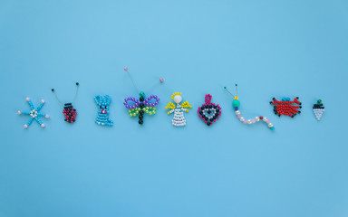 pattern of children's crafts on a blue background.