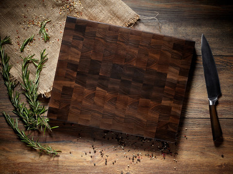 Top view of a beautiful dark cutting board with a knife