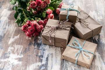 Flowers and gifts for the woman he loves. Women's day concept.