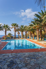pool on the Mediterranean coast in the recreation area of the small Greek village of Sissi