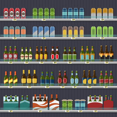 Beer in cans and bottles, standing on the shelf.