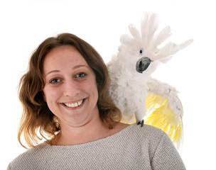 White cockatoo and woman