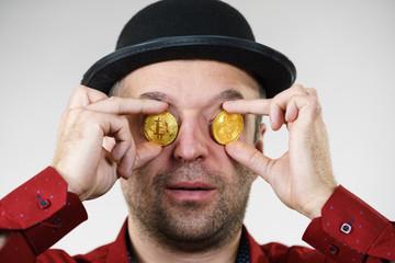 Man having bitcoin in eye