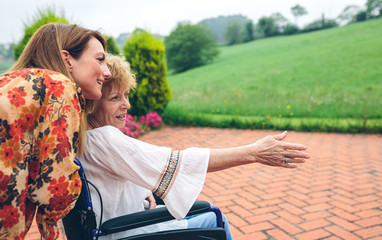 Senior woman in a wheelchair with her daughter