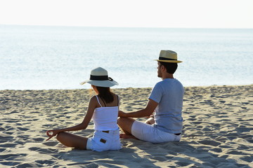 Couples are showing love and exercise. And taking pictures of pre-wedding At the beach with morning sunshine near the sea