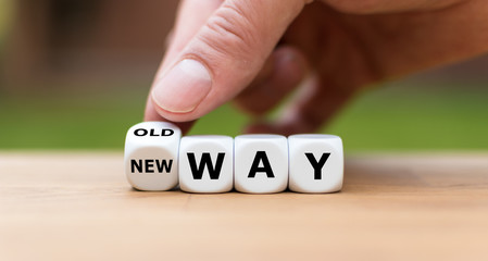 """Hand is turning a dice and changes the expression """"old way"""" to """"new way"""""""