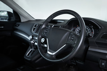 Modern black car dashboard interior , luxury car interior concept . Side profile angle .