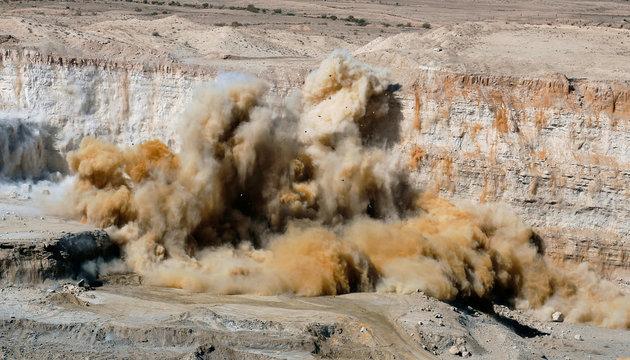 Dynamite explosions blast rock mass at a phosphate mine in Mdhilla