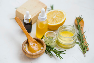 Fototapeta Natural skincare ingredients with manuka honey, lemon, essential oil, clay, balm, rosemary herbs and natural soap, healthy wellness and spa products , natural homemade ingredients obraz
