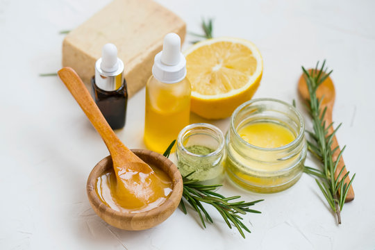 Natural skincare ingredients with manuka honey, lemon, essential oil, clay, balm, rosemary herbs and natural soap, healthy wellness and spa products , natural homemade ingredients