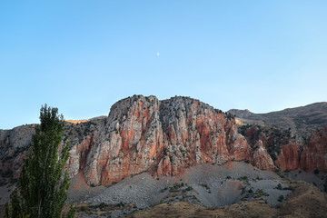 Red stone rock in the mountains at sunset