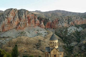 The Christian Apostolic Church Noravank in Armenia on the background of the Caucasus mountains