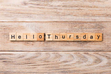hello thursday word written on wood block. hello thursday text on wooden table for your desing, concept