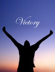 Man Celebrating at Sunset with Victory text