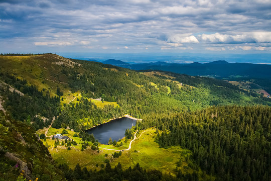 """Vosges mountains summer landscape from the Gazon du Faing overlooking at the Forlet lake (or """"Lac des truites""""), France."""