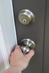 Hand on doorknob