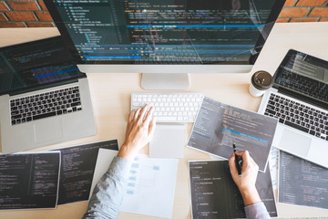 Professional Developer programmer working a software website design and coding technology, writing codes and database in company office, Global cyber connection technology Wall mural