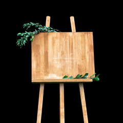 Copy space, your text here. Wooden easel with a board. Isolation on a black background