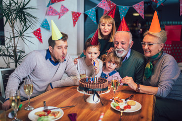 Family celebrating grandfather's birthday together