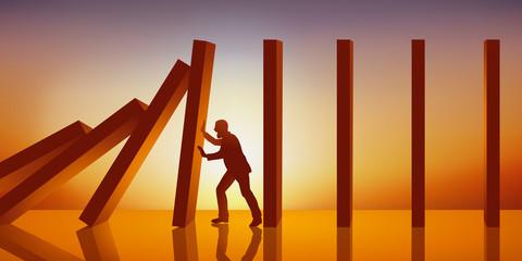 Concept d'une réaction à la chaîne avec un homme qui retient symboliquement un panneau pour l'emêcher de tomber sur les autre et provoquer un effet domino pour abattre un système