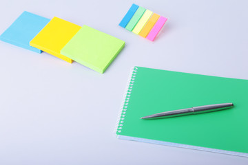 Business concept. Top view of kraft spiral notebook, glasses, smartphone and black pen isolated on background for mockup.