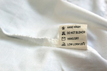 On the seamy side of the clothes there is a tag with instructions for use