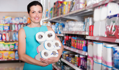 Portrait woman holding pack of toilet paper