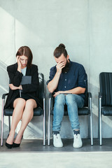 Job interview failure. Upset applicants. Unemployed young woman and man thinking hard. Copy space for text.