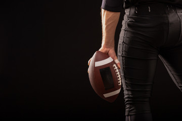 Cropped Image Of Sportsman Holding American Football Ball