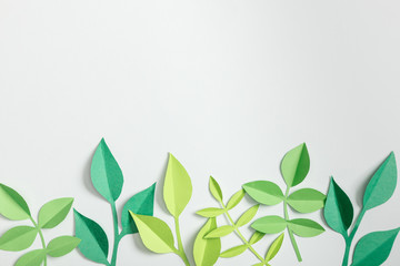 top view of green paper plants with leaves on grey background Wall mural