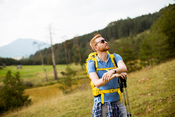 Active healthy man hiking at nature