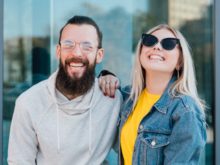 Happy young couple. Leisure time. Casual urban lifestyle. Smiling young man and woman.