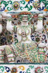 Statue of a Monkey supporting a Prang at Wat Arun