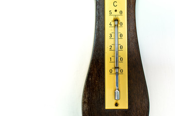 isolated old barometer on white wall