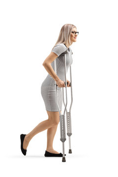 Young woman walking with crutches