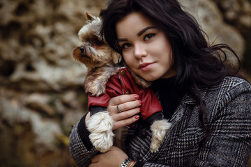 Cute young girl with yorkshire terrier dog