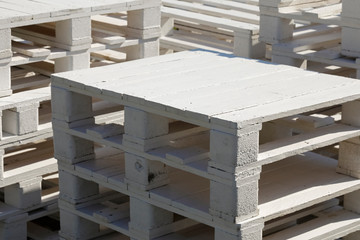 Pile of white wooden pallets